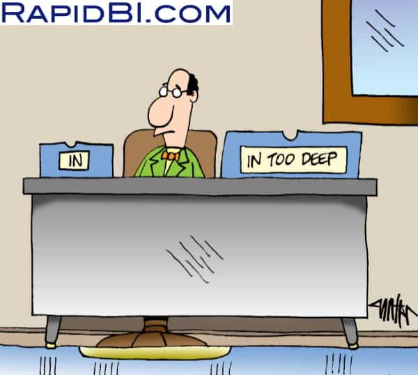 "Man at desk with 2 in trays, ""In"" and ""in too deep"" cartoon"